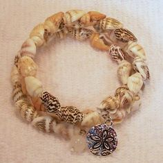Shell Memory Wire Bracelet with SAND DOLLAR CHARM. Visit Our Store twodotts.ecrater.com