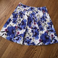 """WHBM floral skirt WHBM floral skirt, size 12. Side zipper, fully lined, 2 pockets, 2 1/4"""" band at waist, some stretch to skirt. Material is 98% cotton, 2% polyester. Lining 100% polyester. Waist 16"""", length 21"""". There is some pilling on the inside lining, see picture. Beautiful floral design. White House Black Market Skirts"""