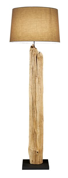 Driftwood Floor lamp made of natural Driftwood with coarse linen shade.     Add a touch of grace to your room with this floor lamp, Scandinavian Designed that provides high quality craftsmanship that is truly magnificent, made of Reclaimed natural Driftwood with a coarse shade to complement it.     Wooden black base 12 wide and 12 deep  Linen shade 21.5 wide, 14 tall and 19 deep  Completely assembled 69 tall  One light socket 60 watts max  Scandinavian designed and made i