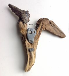 """""""The Angel of Virtue Sings"""" Driftwood Art by Mother Nature.    Handmade by Doctor Driftwood.  Made out of """"all natural"""" handpicked driftwood and stones """"reclaimed"""" from California. """"Where Nature and Style Meet.""""  Follow me at Facebook/DoctorDriftwood and Pinterest/DoctorDriftwood.  Look for me on Flickr/DoctorDriftwood.  Visit DoctorDriftwood.com for sales, more info, and harmony.  Enjoy Nature in your home.  Cheers!"""