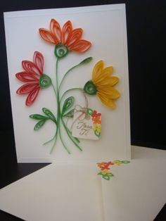 Quilling Flowers from www.universodepapel.es