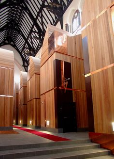 St Mary's Church Hulme, Internal view after conversion to apartments. Each timber pod is a triple height flat inserted into the church space alcoves
