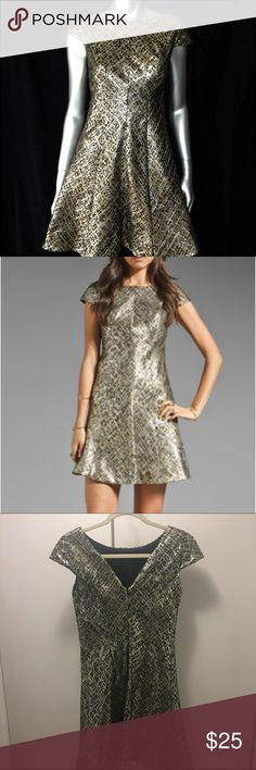 Shoshanna Bethany fit and flare dress gold sz. 2 Shoshanna Bethanie Metallic Jacquard Bethany Dress is perfect for the holiday season. A line cut flatters almost all body types. Beautiful metallic gold color with textured rich fabric. V back detail and capped sleeve. Class Shoshanna brand. Has slight pulling on seam... pictures. Shoshanna Dresses Mini