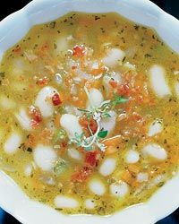 White-Bean Soup with Bacon and Herbs  A light broth loaded with chunky Great Northern beans and topped with a sprinkling of bacon, this soup was inspired by the caldo gallego (a Spanish white-bean soup) Jose Garces serves at Amada.