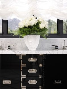 So gorgeous black vanity in this bathroom  via Conspicuous Style Interior Design Blog