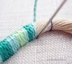 3D embroidery on canvas; make a design with rope and cover with embroidery thread--could make letters or a monogram.
