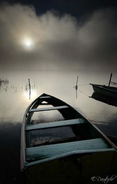 Abandoned boats in the Foggy Mist......Lake Saint-Point, Doubs, France