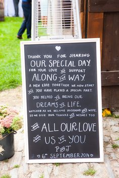 Chalkboard / blackboard thank-you wedding sign - Image by Julie Warner Photography - Wendy Makin Lace Wedding Dress & flower crown for a rustic wedding in a barn with pastel DIY decor, mis-match bridesmaids gowns and groomsmen in bow ties.