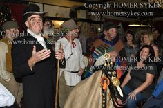 """https://flic.kr/p/qHbR6t   HOODENERS HOODENING HOODEN HORSE KENT UK   Hooden Horse performance at The Bell Inn,   St Nicolas at Wade, Kent UK   The traditional characters are from L to R. The Boy, Waggoner, George, who is the musician, Sam a farm labourer, The Hooden Horse, Mollie, a woman played by a man.  HOMER SYKES   <a href=""""http://homersykes.photoshelter.com/"""" rel=""""nofollow"""">homersykes.photoshelter.com/</a>  Keyword """" Hooden Horse """""""