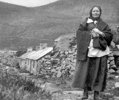 Mrs Ann Gillies (née Ferguson), pictured here walking down the Street with her knitting in her hands, was born on Hirta in 1866. Ann was the daughter of the senior St Kildan, Donald Ferguson