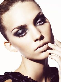 The sexy strength style expression is what this image evokes. Skin has minimal foundation while using bronzer in the natural contours, gives more structure & intensifies the overall feel. Defined brows is a must, while the eye dressed in all black captivates! If your look is powerful make sure the lip stays nude.   Tracy Marie- TBBD