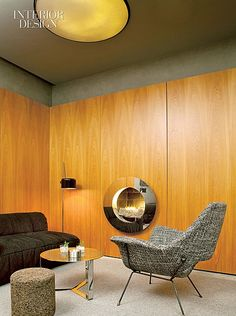 Cosmopolitan Cocktail: Enrique Norton and Arnaud Montigny's Hôtel Americano | At El Privado, a reservation only lounge, a Cini Boeri sofa and a Joe Colombo lamp gather near a fireplace ringed in mirror-polished stainless steel.