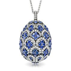 Faberge ZénaÏde sapphire egg locket pendant.  Blue sapphires and white diamonds set in 18 carat white gold, 28mm in height.  Design inspired by traditional Uzbek textiles.