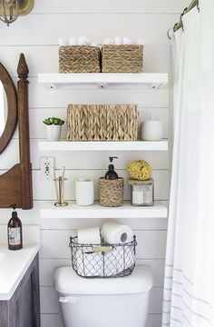 After they re-sheetrocked the walls, the couple installed inexpensive, faux shiplap on top and painted the entire room white. Rachel cleverly chose paint with a satin-finish so that light entering the (Diy Bathroom Storage) Country Bathroom Decor, Shelves, Interior, Small Bathroom Decor, Shelves Above Toilet, Small Bathroom, Apartment Decor, Simple Bathroom, Easy Bathroom Organization