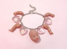 Doll Head charm bracelet by dollache on Etsy