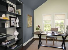 Benjamin Moore Paint Colors - Blue Home Office Ideas - Boldly Accented Home Office - Paint Color Schemes . . . . . An accent wall of deep blue-gray Normandy (2129-40) is sophisticated and modern. . . . . . Accent Wall (side wall & ceiling) - Normandy (2129-40); Wall (back wall by windows) - Cream Silk (2146-60); Bookshelf Inset & Trim (back wall of bookshelf, and floor & window trim) - White Dove (OC-17).