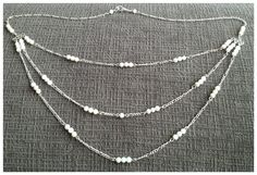 Three strand natural white shell bead an silver plate Figaro chain bridal necklace. Nice for a bride or mother of the bride.