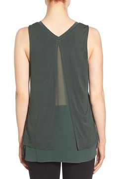 Absolutely love the fresh and flirty fresh and flirty split back of this V neck top, and the green color is perfect for fall. Adding to the NSale shopping bag now.