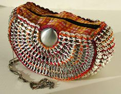 Shamelss plug - If you like the bag please vote for it after April 1st in this Project Yarnway thread. Thanks!  Materials: About 540 pop tabs 2 soda can bottoms 1 chain material for lining 1 zipper...