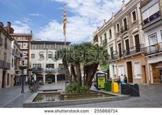 CALELLA, SPAIN - JULY 20, 2013: The main square of Calella on July 20, 2013. City on the Costa Brava - a popular holiday destination of tourists from all European countries