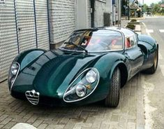 luxury cars 1968 Alfa Romeo 33 Stradale - and as with all Alfas, it looks even more smashing in dark green. Auto Design, Design Autos, Bike Design, Maserati, Ferrari, Lamborghini, Bugatti, Bmw Classic Cars, Classic Sports Cars