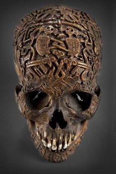 h3atherashl3y:  ^Tibetan Skull;aged 300 years Skulls like this were carved to take a curse off of a family, or to guide a mislead soul on the right path. The symbols refer to Tibetan Buddhism  There is no easy well to tell if they were made in Tibet or China. It is also not easy to know when they were made. Some symbols are inlaid in the skull with metal after which is buffed, and polished. some are carved into the bone, and the mandible are secured onto the upper part of the skull