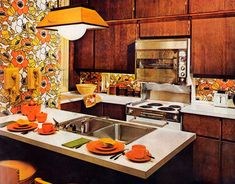 "1960's ""modern"" kitchen...big floral wallpaper, bright colors, earthtones...surprised about the microwave, tho.  This kitchen was featured in the February 1962 issue of House Beautiful."