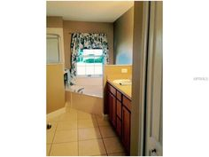 Master Bath has garden tub and separate shower/ double sinks
