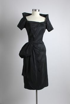 I was born in the wrong decade.  HEMLOCK VINTAGE CLOTHING : 1950's Black Sculptural Cocktail Dress