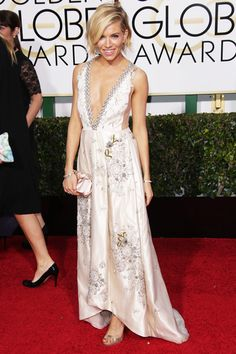The Golden Globes' Most Stunning Red Carpet Moments #refinery29  http://www.refinery29.com/2015/01/80582/golden-globes-2015-red-carpet-best-dressed-celebrities#slide-15  Sienna Miller While most actresses and red carpet starlets change up their styles on a whim, Sienna Miller has stayed true to her boho roots for the past decade. This plunging-neck, embroidered Miu Miu gown was fairy-tale perfection.