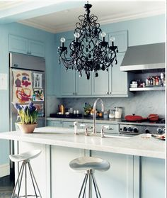 A black chandelier makes a dramatic statement in a kitchen  | domino.com