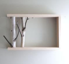 "white birch forest - natural white birch wood wall art/shelf. $40.00, via Etsy.  I like using branches as ""book ends"" on this shelf..."