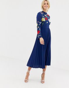 1d5d35e1dd Shop ASOS DESIGN Tall pleated high neck midi dress with embroidery at ASOS.