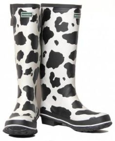 cow print rain boots..oh my geez! I would lovwe whoever left these under my tree!!! (: