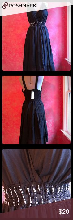 Cassees dress CASSEES dress.Black cotton dress with elastic waist. Pretty beaded  accent in the front and on the straps. Crisscross bustline cassees Dresses Midi