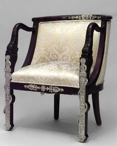 French Empire style (19th Cent) mahogany round back dolphin arm chair with bronze trim and gold upholstery