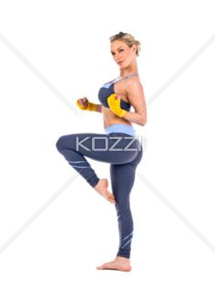 side view of a young female fighter posing. - Side view of a young female fighter posing while standing against white background, Model: Selena Stevens