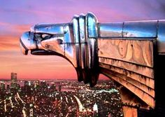 Chrysler Building, 1930, New York City. Eagle-headed gargoyles comparable to hood ornaments. These and other surfaces of the building were made with Nirosta stainless steel, because of its low-maintenance, and the beauty of its color.