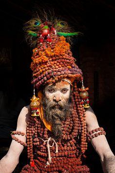 "Kumbh Mela Spiritual Festival, pilgrimage Allahabad, India This sadhu (renunciate) is almost buried in the malas (lit. ""garlands"") of rudrasksha beads he is wearing."