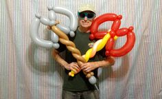 I wanted to design a Big Balloon Battle Axe that could be constructed quickly enough for deluxe line work, and I think I succeeded! Easy Balloon Animals, Ballon Animals, Balloon Toys, Balloon Crafts, Balloon Decorations, Twisting Balloons, Balloon Shapes, Balloon Sword, Sculpture Ballon