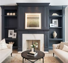 In van deusen blue.Living room condo staging  Book case wall and fireplace