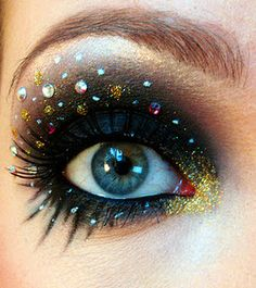 black glittery eye #makeup w/ rhinestones + gold #glitter.