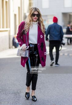 A guest wearing a purple coat, Dior bag, black vinyl pants outside Missoni during Milan Fashion Week Fall/Winter 2017/18 on February 25, 2017 in Milan, Italy.