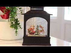 542b432b60989 LIMITED TIME SPECIAL PRICE Battery operated picture window water lantern  featuring Santa driving his reindeer pulled