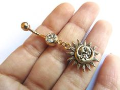 Celestial Golden Moon And Sun Belly Button Ring Jewelry Gold Charm Dangle Navel Piercing Bar Barbell from Azeeta Designs. Saved to Belly Button Rings. Belly Button Piercing Jewelry, Bellybutton Piercings, Navel Piercing, Body Piercings, Cute Belly Rings, Dangle Belly Rings, Belly Button Rings, Jewelry Tattoo, Body Jewelry