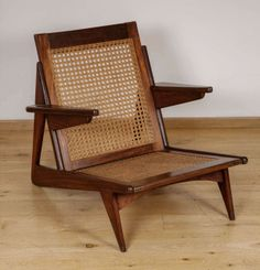 Anonymous; Mahogany and Cane Armchair, 1950s.