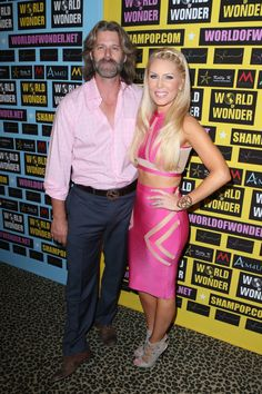 Gretchen Rossi in a shiny pink two piece with Slade Smiley in a pink shirt