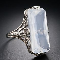 Extraordinary FACETED moonstone in the most graceful setting of 14karat white gold. Almost an inch of stone. Glorious, worn on a tiny ,tiny ,Edwardian finger.