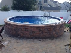 EPHenry wall stone around above ground swimming pool