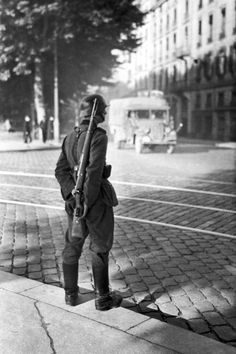 The start of the occupation in Lyon, France in June, 1940 - Sentry on the University's bridge.